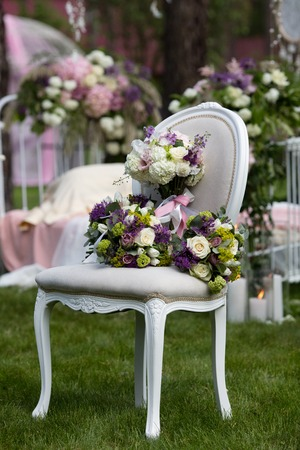 Beautiful wedding bouquet of colorful flowers on a vintage chair on the nature in sunset light, decorations, preparing for the wedding, details, boudoir