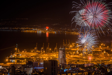Fireworks over city of Haifa, Israel, celebrating Independence Day of Israel. Stock Photo