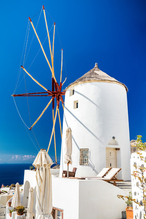 Romantic wind mill in Oia village at sunset. Beautiful views on mediterranean sea. Santorini,Thira island .Cyclades. Greece. Europe. Stock Photo