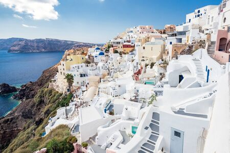 White architecture on Santorini island, Greece. Beautiful landscape with sea view and blue domes Stock Photo
