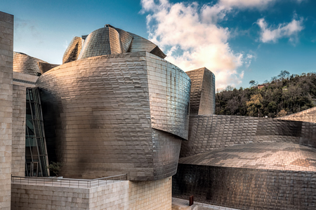 admired: SPAIN, BILBAO - APRIL 06, 2016: The Guggenheim Museum Bilbao. Guggenheim Museum Bilbao is one of the most admired works of contemporary architecture. Editorial