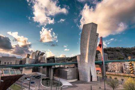 futuristic city: SPAIN, BILBAO - APRIL 06, 2016: The Guggenheim Museum Bilbao. Guggenheim Museum Bilbao is one of the most admired works of contemporary architecture. Editorial