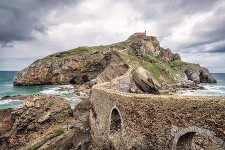 San Juan de Gaztelugatxe is church dedicated to John the Baptis connected to the mainland by a man-made bridge, Bermeo, Basque Country,Spain.