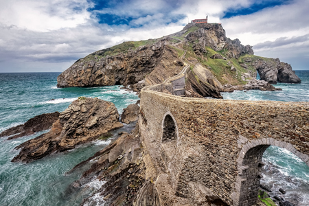 San Juan de Gaztelugatxe is church dedicated to John the Baptis connected to the mainland by a man-made bridge, Bermeo, Basque Country,Spain.
