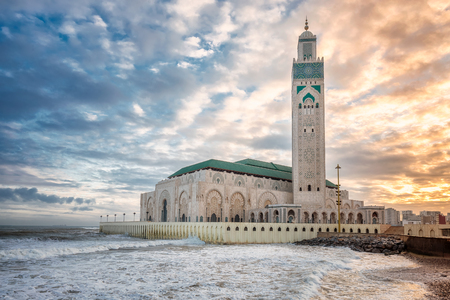 morning blue hour: The Hassan II Mosque  largest mosque in Morocco. Shot  at sunrise in Casablanca. Stock Photo