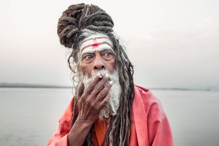 Portrait of sadhu smoking in the boat, Varanasi, India. Stock Photo
