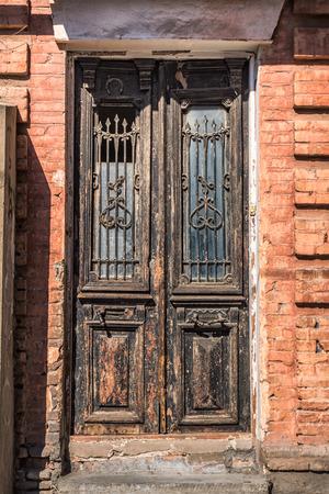Old wooden door on streets of Tbilisi, Georgia.