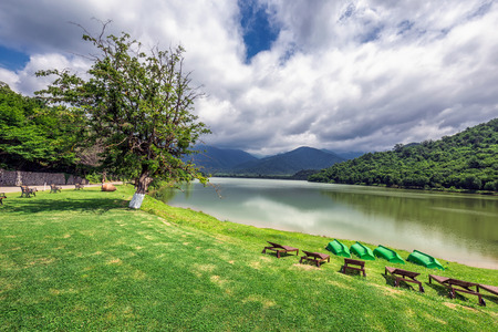 The virgin forest surrounding the resort, the lake in the front where the small rivers of Bursa and Chagurgula flow into, vast Alazani valley in the backyard and  beautiful panoramic views. Stock Photo