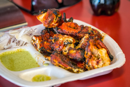 Close up portrait of indian tandoori chicken with souce. Stock Photo