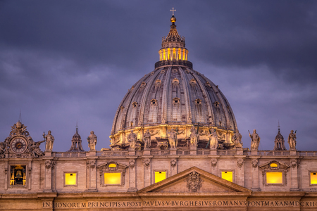 Sunrise over the St. Peters Basilica in Vatican City. Morning at the most famous landmark, empty of people street, cloudy sky. Stock Photo