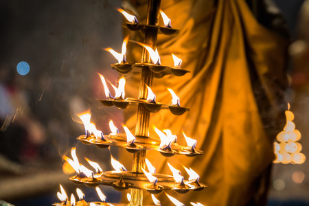 Candles used in performance of religious Ganga Aarti ritual fire puja at Dashashwamedh Ghat in Varanasi, Uttar Pradesh, India.