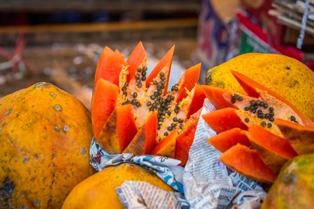 karnataka: Papaya fruit India cut open at Agra market, India.