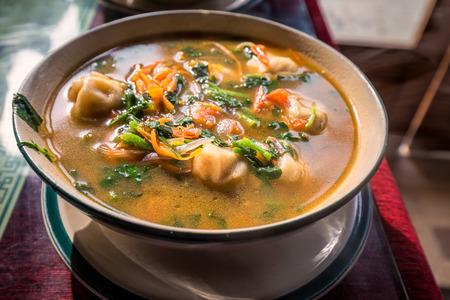 tibetian: Traditional tibetian food is momo soup with vegetables  Darjeeling, India. Stock Photo