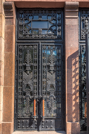 Old rustic gate with soviet decor elements at Kiev, Ukraine.