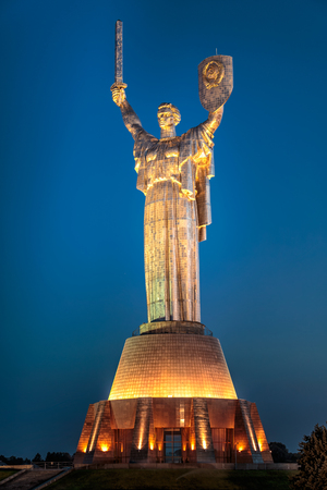 architecture monumental: The Motherland Monument is a monumental statue in Kiev, the capital of Ukraine. The sculpture is a part of the Museum of The History of Ukraine in World War II, Kiev. Stock Photo
