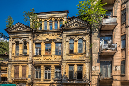 Exterior of old yellow building located in ancient historic district of Kiev, Ukraine.