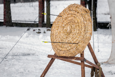 Straw target for archery ат Shrovetide (Pancake week) festival with outdoor snow activities including: armwrestling, bag fighting, cubes moving at Dudutki, Belarus. Stock Photo