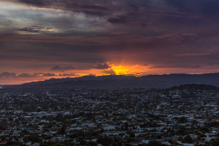 Great sunset over city at Auckland, New Zealand.