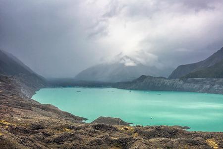 Glacier lake with turquoise blue water and mountains landscape. Winter mountain landscape with snow and glacier lake. Tasman glacier, Aoraki - Mount Cook National Park, New Zealand.