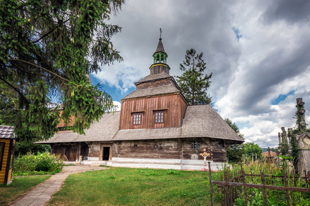 Wooden Church of the Holy Spirit with a magnificent iconostasis located in Rohatyn, Ukraine.