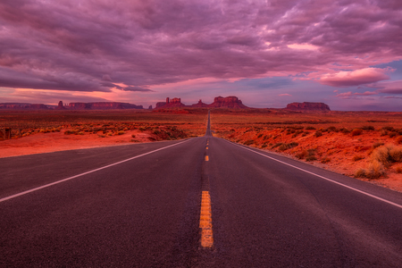 Amazing sunrise with pink, gold and magenta colors near Monument Valley, Arizona, USA.