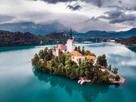 Amazing View On Bled Lake, Island,Church And Castle With Mountain Range (Stol, Vrtaca, Begunjscica) In The Background-Bled, Slovenia, Europe Editorial