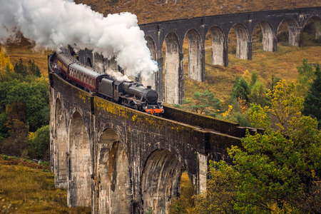 The Glenfinnan Viaduct is a railway viaduct on the West Highland Line in Glenfinnan, Inverness-shire, Scotland. Stock Photo - 113998708