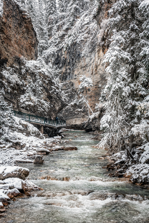 Johnston Canyon under heavy snow at Banff National Park, Canada.
