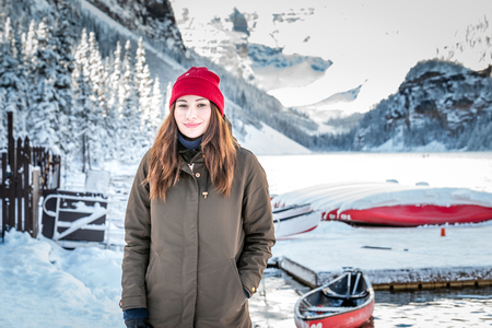 Beautiful girl with red hat near Lake Louise, Banff, Canada.
