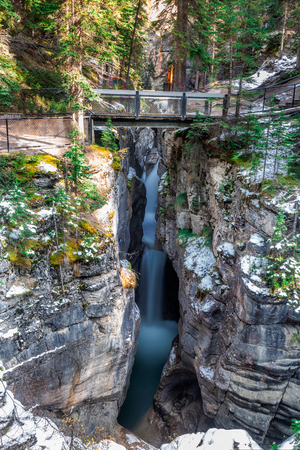 Celestic water flowing through the Maligne Canyon in Jasper National Park, Alberta, Canada