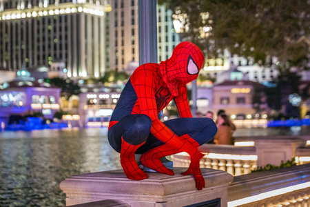 LAS VEGAS - JANUARY 24, 2018 : Spiderman near fountains of Bellagio have been featured in several movies, is a large dancing water fountain synchronized to music on the Las Vegas Strip in Paradise, Nevada.