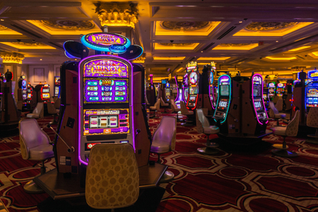LAS VEGAS - JANUARY 24, 2018 : The Venetian Resort Hotel & Casino slot machines and gamblers. located in Nevada, USA. Editorial