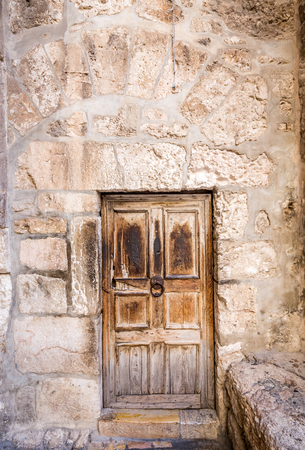 Ancient wooden door and stone walls in Jerusalem, Israel. Stock Photo