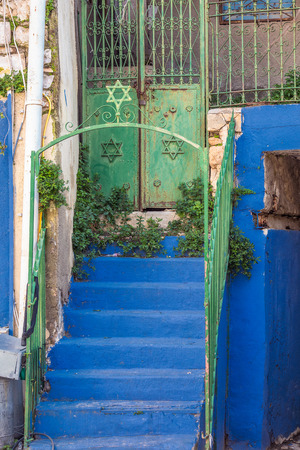 Door in blue streets of Holy city Safed, Israel.