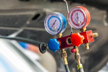 Close-up on gauges of air compressor.