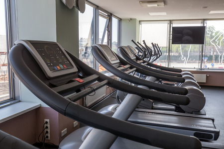 An interior shot of a club gym with all the treadmill.