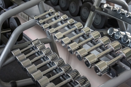 Rack of iron weights in a gym. Close up shot.