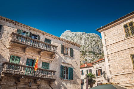 Kotor, Montenegro. Bay of Kotor bay is one of the most beautiful places on Adriatic Sea, it boasts the preserved Venetian fortress, old tiny villages, medieval towns and scenic mountains. Stock Photo - 124858632
