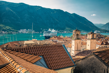 Kotor, Montenegro. Bay of Kotor bay is one of the most beautiful places on Adriatic Sea, it boasts the preserved Venetian fortress, old tiny villages, medieval towns and scenic mountains. Stock Photo - 124859353