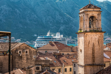 Kotor, Montenegro. Bay of Kotor bay is one of the most beautiful places on Adriatic Sea, it boasts the preserved Venetian fortress, old tiny villages, medieval towns and scenic mountains. Stock Photo - 124862415