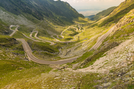 Top view of the famous winding road transfagaras in the picturesque mountainous areas on a sunny day in Romania