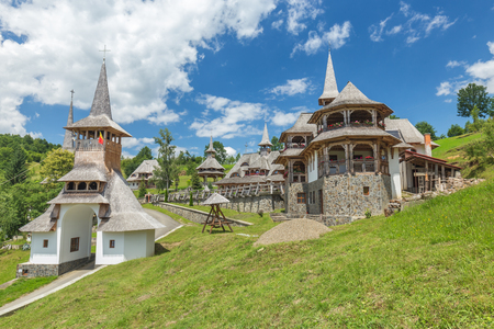 Wooden Churches of MaramureÈ™ listed in Romania at sunny day Reklamní fotografie