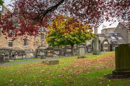 Edinburgh, Scotland - October 10, 2017: Greyfriar's Kirk, an ancient and spooky cemetery just behind the Grassmarket area. Stock Photo