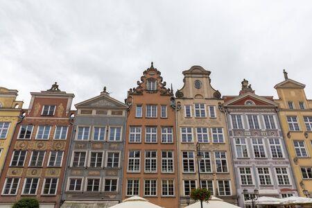 Warsaw, Poland - June 25 2018: Beautiful and stylish buildings in the streets of the old town are photographed from the bottom corner in Gdansk in Poland at cloudy day