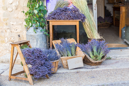Large selection of bunches of lavender sold in a souvenir shop in Provence, France on a warm day