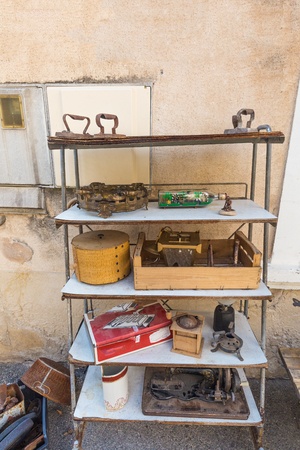 Various and ancient things are sold at a flea market in the city of Provence in France