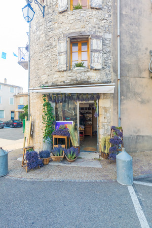 Large selection of bunches of lavender sold in a souvenir shop in Provence, France on a warm day Stock Photo
