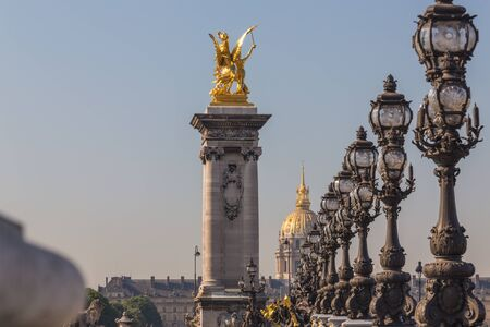 The Alexander III Bridge is made in the form of a single bridge over the River Seine, located in Paris between the Champs Elysees and the House of Invalids.