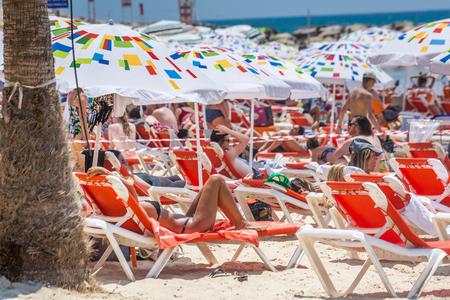 Tel Aviv, Israel - June 14 2019: Couple relaxing at the beach.