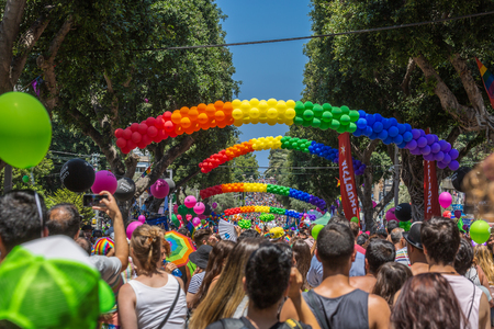 Tel Aviv, Israel - June 14 2019: 21th annual Tel Aviv Pride Week. At the parade, people walking, dancing, singing, waving banners and rainbow flags celebrating the largest LGBT event in the middle east. Redakční